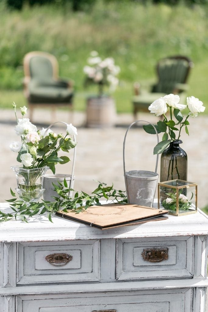 Vintage Wood Chairs And Table With Flower Decoration In Garden.